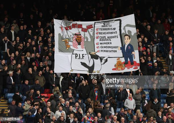 Crystal Palace fans display a banner attacking the Premier League for approving Newcastle's Saudi-backed takeover seen before the Premier League...