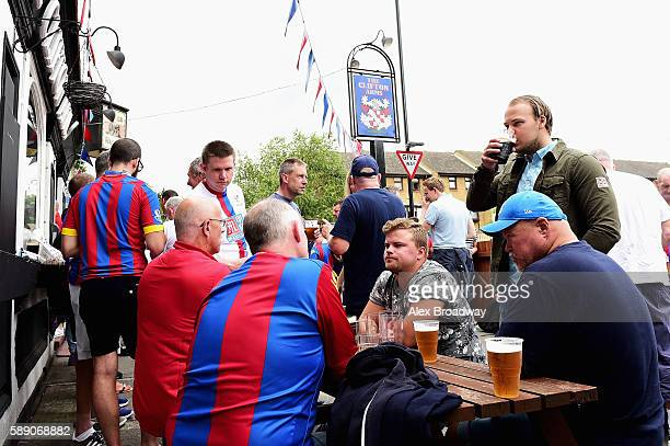 Crystal Palace fans enjoy the pre match atmosphere in a local pub during the Premier League match between Crystal Palace and West Bromwich Albion at...