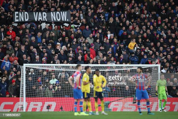 Crystal Palace fans hold up a protest banner against VAR during the Premier League match between Crystal Palace and Arsenal FC at Selhurst Park on...