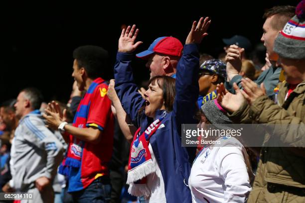 Crystal Palace fans surport their team during the Premier League match between Crystal Palace and Hull City at Selhurst Park on May 14 2017 in London...