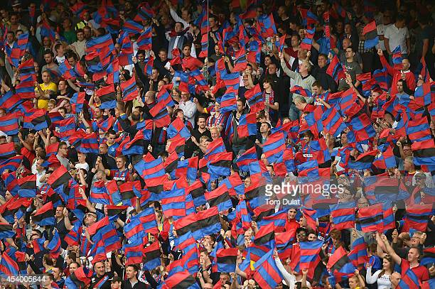 Crystal Palace fans wave flags during the Premiere League match between Crystal Palace and West Ham United at Selhurst Park on August 23 2014 in...