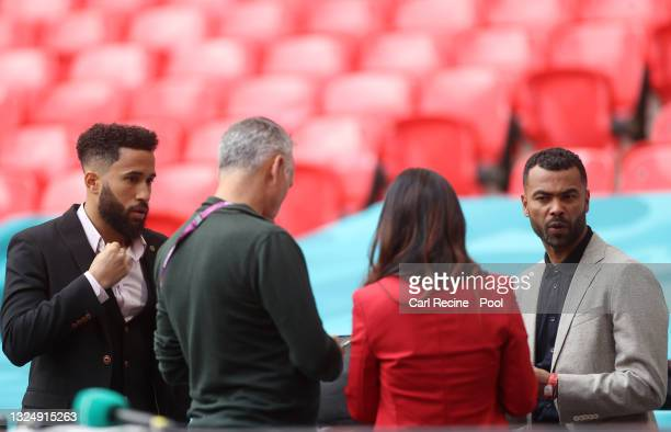 Crystal Palace footballer and TV Presenter, Andros Townsend and Former England International and TV Presenter, Ashley Cole look on prior to the UEFA...