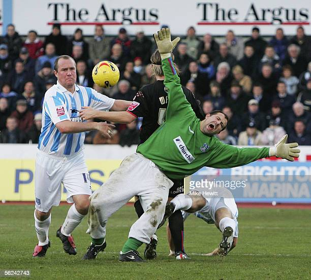 Crystal Palace goalkeeper Gabor Kiraly goes down as he is pressurised by Guy Butters of Brighton during the CocaCola Champioship football league...