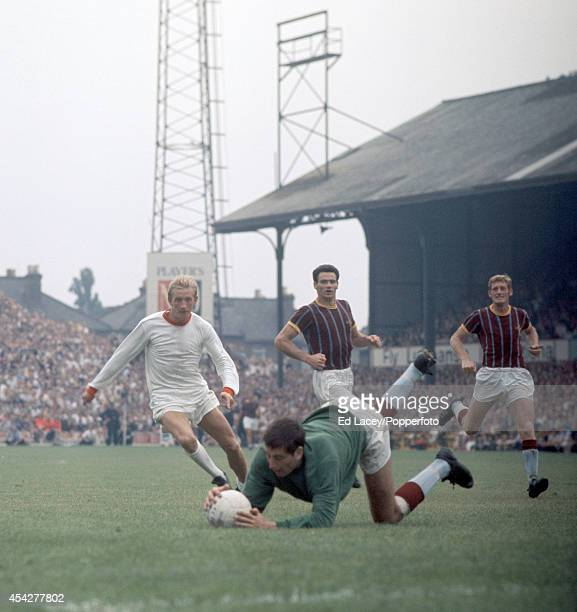 Crystal Palace goalkeeper John Jackson dives to save at the feet of Manchester United striker Denis Law during the Division One match at Selhurst...
