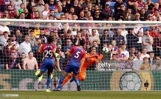 Crystal Palace goalkeeper Vicente Guaita saves a headed chance from Huddersfield Town's Chris Lowe from close range during the Premier League match...