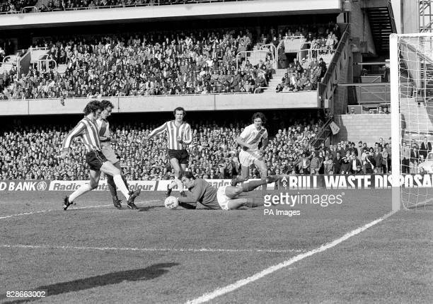 Crystal Palace keeper Paul Hammond saves from the feet of Southampton's Mike Channon during the FA Cup semi-final at Stamford Bridge.
