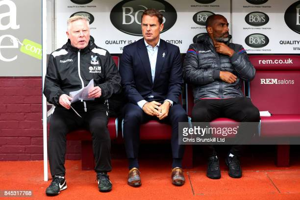 Crystal Palace manager Frank De Boer looks on next to assistants Sammy Lee and Orlando Trustfull during the Premier League match between Burnley and...