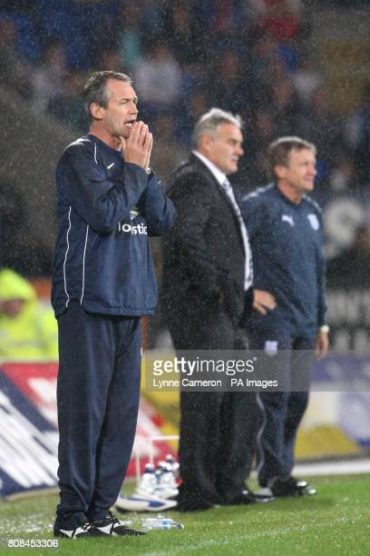 Crystal Palace manager George Burley on the touchline Cardiff City manager Dave Jones and Assistant manager Terry Burton on the touchline