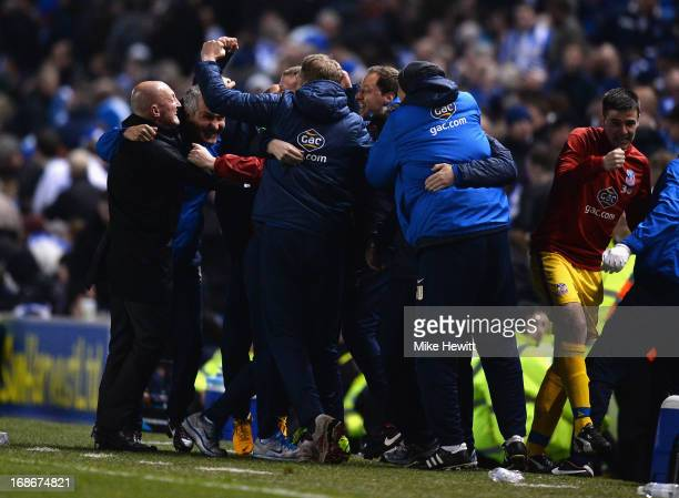 Crystal Palace manager Ian Holloway and his bench celebrate during the npower Championship Play Off Semi Final Second Leg between Brighton Hove...