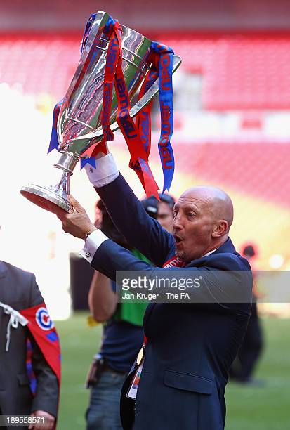 Crystal Palace Manager Ian Holloway celebrates his team's promotion with the trophy at the end of the npower Championship Play-off Final match...