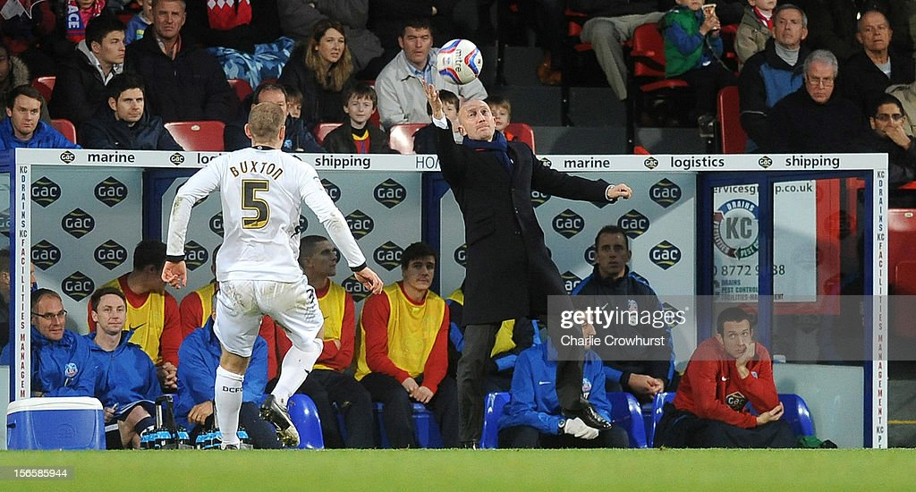 Crystal Palace manager Ian Holloway tries to catch the ball during the npower Championship match between Crystal Palace and Derby County at Selhurst Park on November 17, 2012 in London, England.