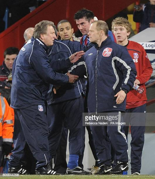 Crystal Palace manager Neil Warnock argues with the fourth official after his player Alan Lee recieved a head injury