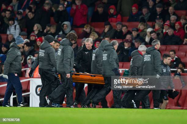 Crystal Palace manager Roy Hodgson checks on Crystal Palace's Yohan Cabaye as he is stretchered off during the Premier League match between Arsenal...