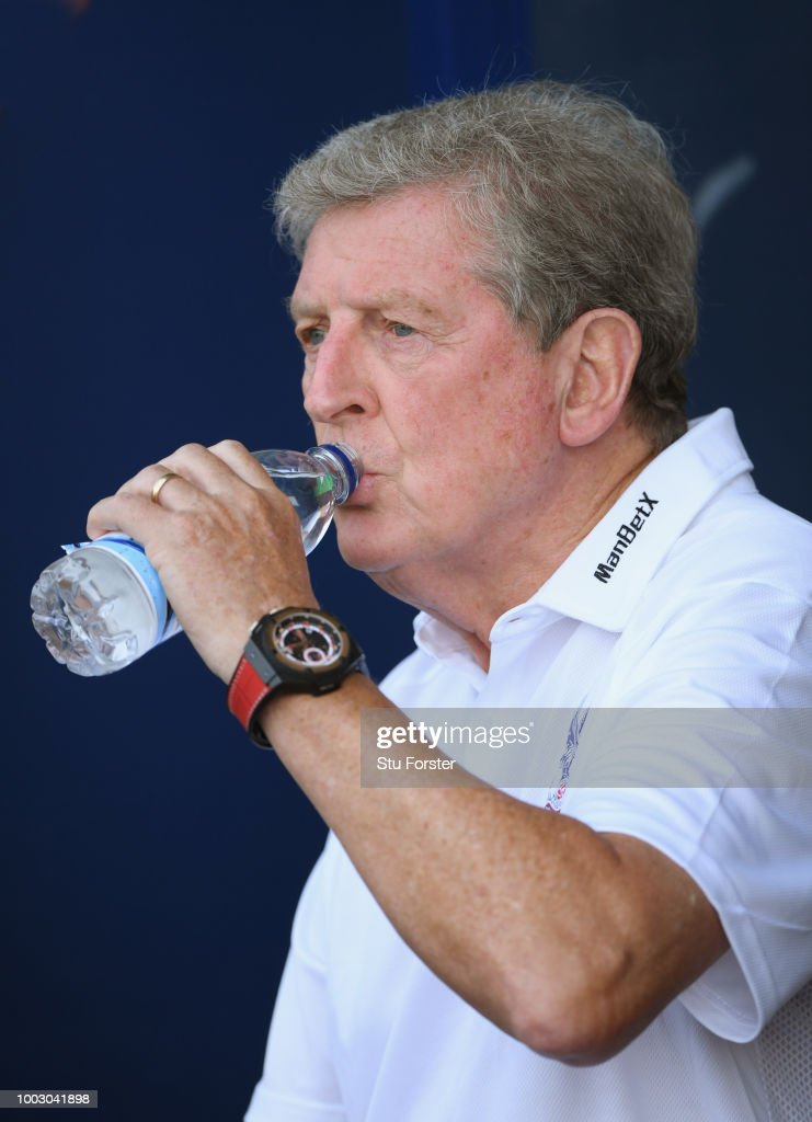 Crystal Palace manager Roy Hodgson drinks a bottle of water during a Pre-Season Friendly match between Oxford United and Crystal Palce at Kassam Stadium on July 21, 2018 in Oxford, England.