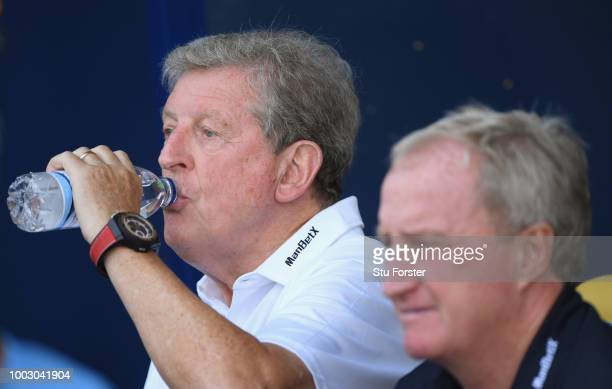 Crystal Palace manager Roy Hodgson drinks a bottle of water during a PreSeason Friendly match between Oxford United and Crystal Palce at Kassam...