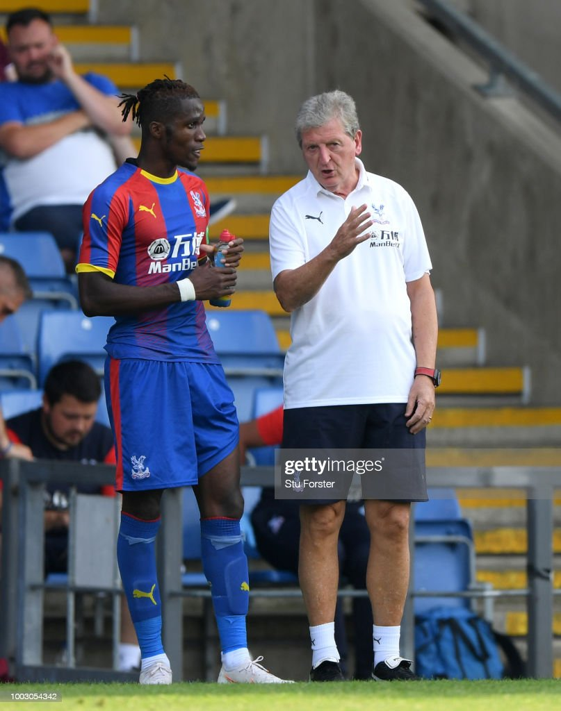 Crystal Palace manager Roy Hodgson talks with striker Wilfried Zaha during a Pre-Season Friendly match between Oxford United and Crystal Palce at Kassam Stadium on July 21, 2018 in Oxford, England.