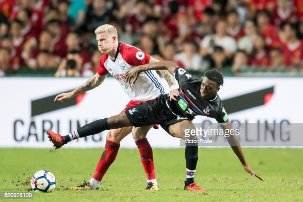 Crystal Palace midfielder Aaron WanBissaka fights for the ball with West Bromwich Albion midfielder James McClean during the Premier League Asia...