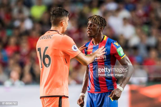 Crystal Palace midfielder Wilfried Zaha confronts with Liverpool FC midfielder Marko Grujic during the Premier League Asia Trophy match between...