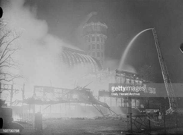 Crystal Palace on fire 30 November 1936 Water being pumped onto the Crystal Palace Sydenham London In the centre is one of the two water towers...
