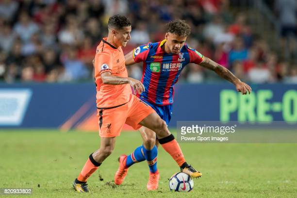 Crystal Palace player Michael Phillips fights for the ball with Liverpool FC midfielder Philippe Coutinho during the Premier League Asia Trophy match...