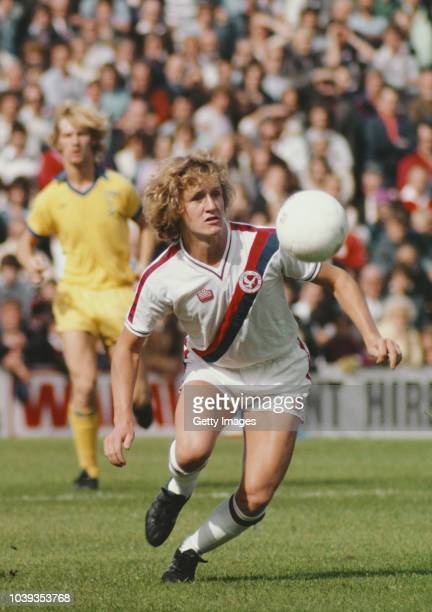 Crystal Palace player Peter Nicholas in action wearing a classic Admiral kit as Sunderland defender Shaun Elliott looks on during a Division Two...
