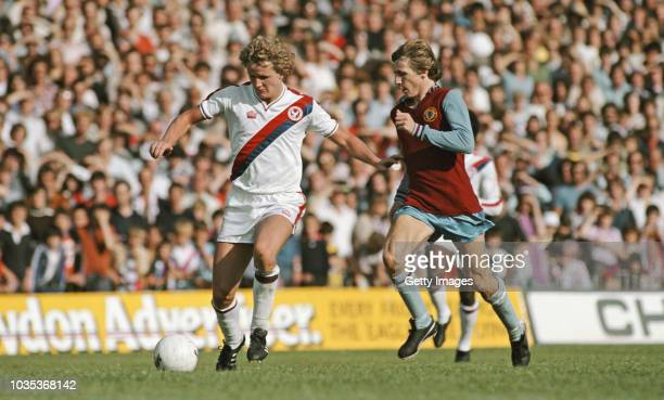 Crystal Palace player Peter Nicholas wearing an admiral kit holds off the challenge of Villa schemer Gordon Cowans during a First Division match...