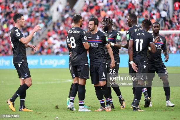 Crystal Palace players celebrate a goal during the thirdplace playoff match of the Premier League Asia Trophy football tournament between West...