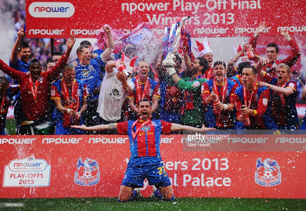 Crystal Palace players celebrate victory with the trophy after the npower Championship Play-off Final match between Watford and Crystal Palace at Wembley Stadium on May 27, 2013 in London, England.