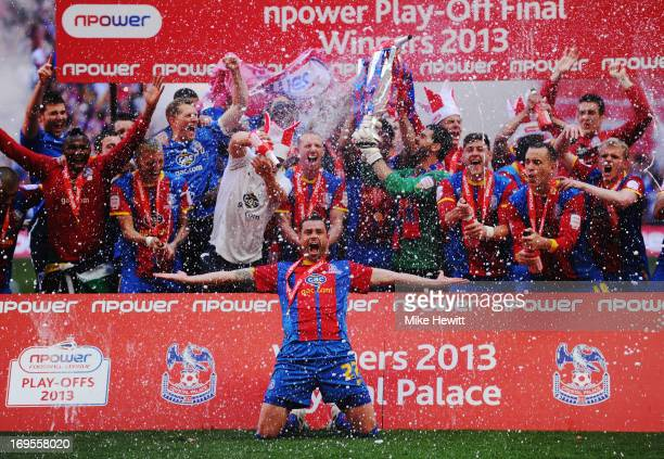Crystal Palace players celebrate victory with the trophy after the npower Championship Play-off Final match between Watford and Crystal Palace at...
