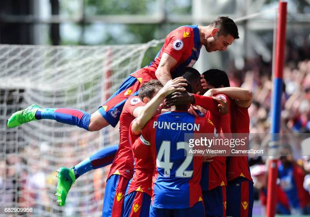 Crystal Palace players congratulate Christian Benteke as he scores his sides second goal during the Premier League match against Hull City at...