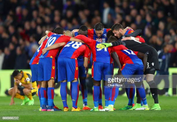 Crystal Palace players huddle during the Premier League match between Crystal Palace and Arsenal at Selhurst Park on April 10 2017 in London England
