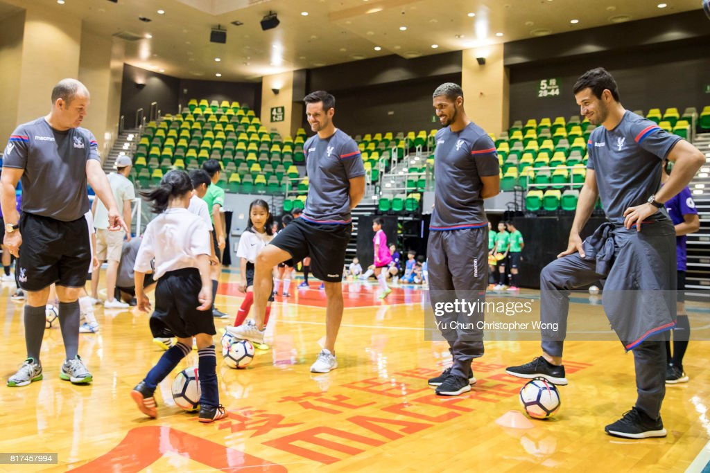 Crystal Palace players Luka Milivojevic (r)l, Ruben Loftus-Cheek (2nd right) and Scott Dann (3rd right), attend the Premier League Asia Trophy Skills Session at Macpherson Stadium on July 18, 2017 in Hong Kong, Hong Kong.
