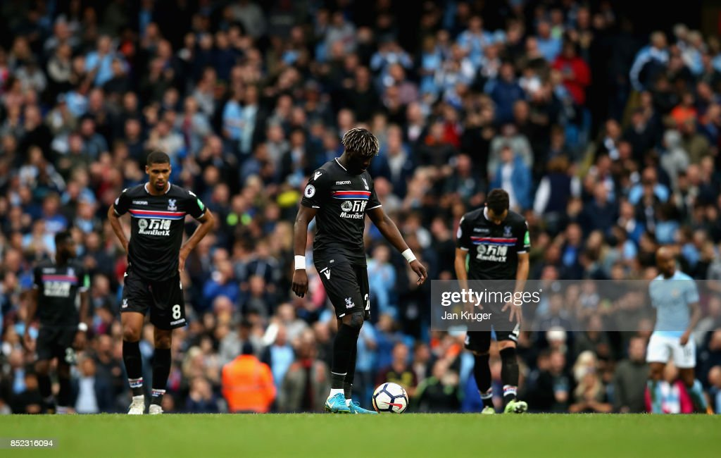 Crystal Palace players show dejection after Chelsea's fourth goal during the Premier League match between Manchester City and Crystal Palace at Etihad Stadium on September 23, 2017 in Manchester, England.