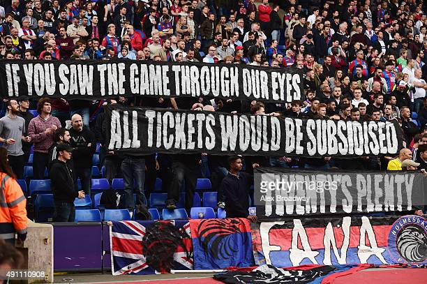 Crystal Palace supporters hold banners to protest against ticket price hike during the Barclays Premier League match between Crystal Palace and West...