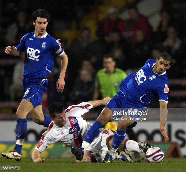 Crystal Palace's Alan Lee tackles Birmingham City's Hameur Bouazza as Birmingham City's Liam Ridgewell looks on during the CocaCola Championship...