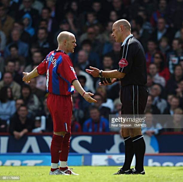 Crystal Palace's Andrew Johnson has words with referee Howard Webb after being booked against Southampton