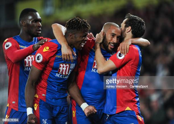 Crystal Palace's Andros Townsend celebrates scoring the opening goal with Wilfried Zaha Yohan Cabaye and Christian Benteke during the Premier League...