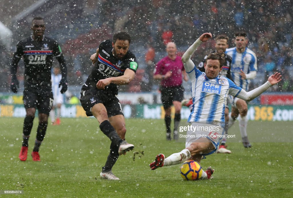 Crystal Palace's Andros Townsend sees his shot blocked by Huddersfield Town's Chris Lowe during the Premier League match between Huddersfield Town and Crystal Palace at John Smith's Stadium on March 17, 2018 in Huddersfield, England.