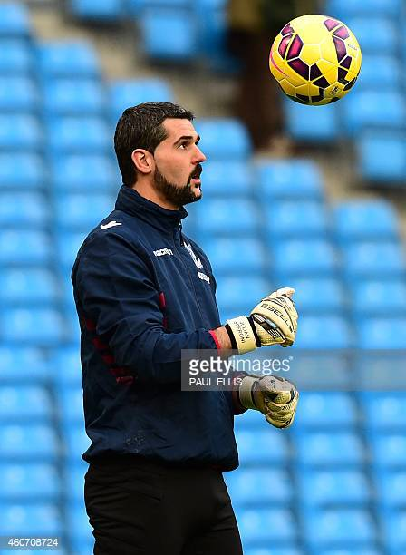 Crystal Palace's Argentinian goalkeeper Julian Speroni warms up ahead of the English Premier League football match between Manchester City and...