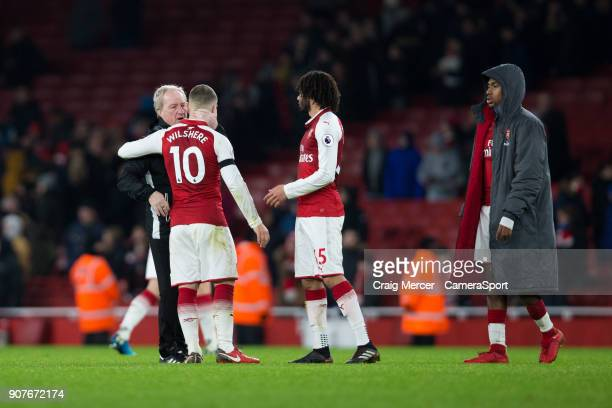 Crystal Palace's assistant manager Ray Lewington has a word with Arsenal's Jack Wilshere at full time during the Premier League match between Arsenal...