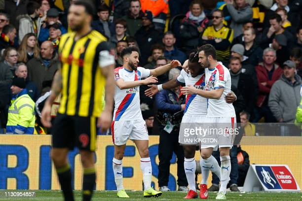 Crystal Palace's Belgian striker Michy Batshuayi celebrates after scoring with Crystal Palace's English midfielder Andros Townsend during the FA Cup...