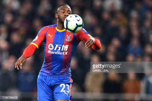 Crystal Palace's Belgian striker Michy Batshuayi controls the ball during the English Premier League football match between Tottenham Hotspur and...