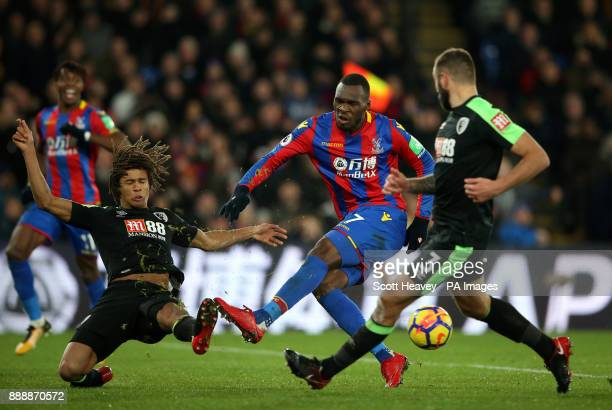 Crystal Palace's Christian Benteke and Bournemouth's Nathan Ake battle for the ball during the Premier League match at Selhurst Park London
