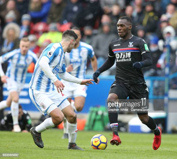 Crystal Palace's Christian Benteke and Huddersfield Town's Christopher Schindler during the Premier League match between Huddersfield Town and...