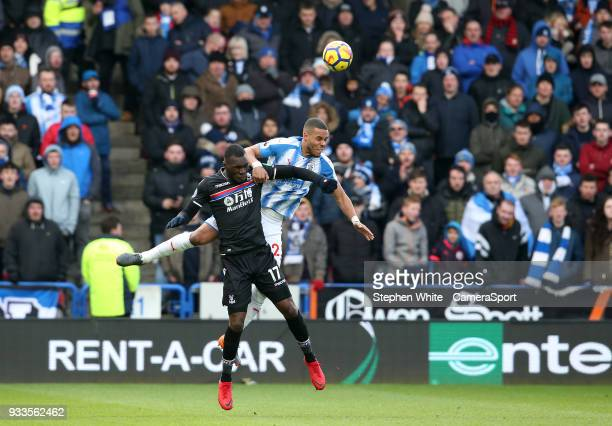 Crystal Palace's Christian Benteke and Huddersfield Town's Mathias Zanka Jorgensen during the Premier League match between Huddersfield Town and...