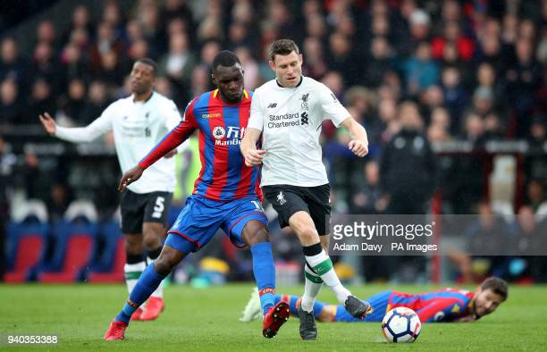 Crystal Palace's Christian Benteke and Liverpool's James Milner battle for the ball during the Premier League match at Selhurst Park London