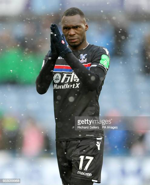 Crystal Palace's Christian Benteke appalauds the fans after the final whistle during the Premier League match at the John Smith's Stadium Huddersfield