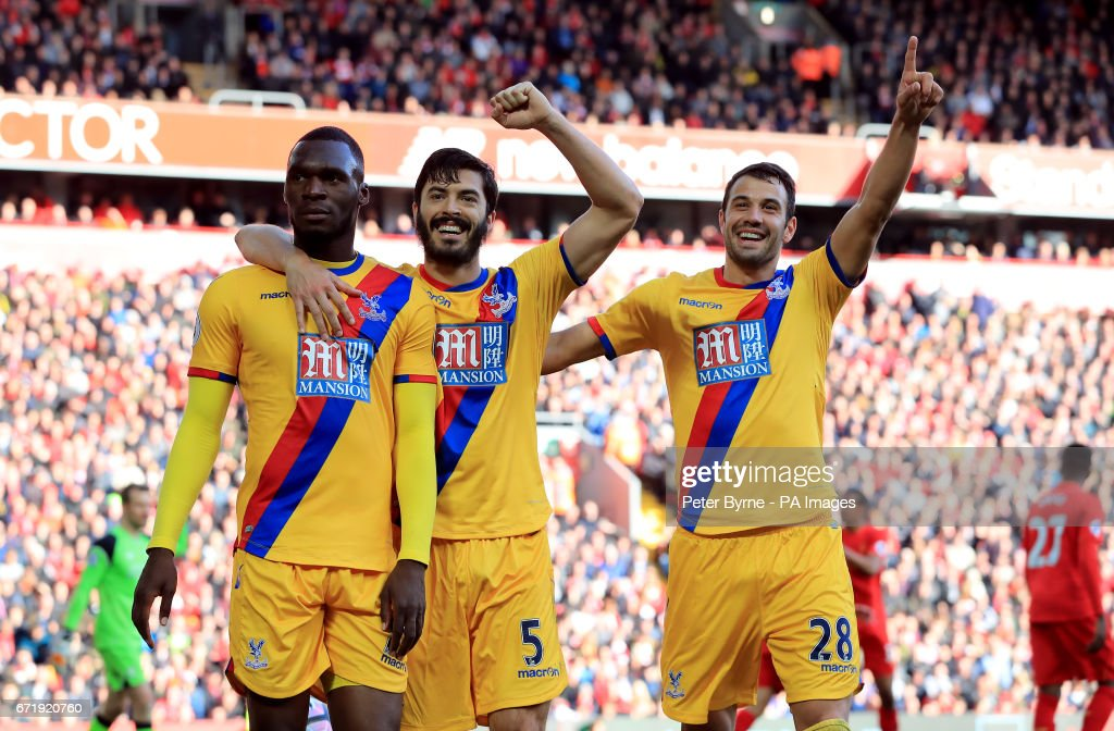Crystal Palace's Christian Benteke celebrates scoring his side's second goal of the game with his team-mates during the Premier League match at Anfield, Liverpool.