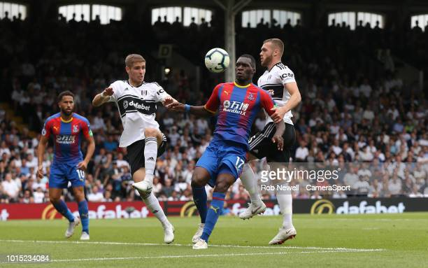 Crystal Palace's Christian Benteke challenges Fulham's Maxime Le Marchand and Calum Chambers during the Premier League match between Fulham FC and...