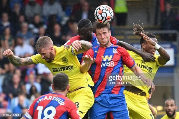 Crystal Palace's Danish defender Joachim Andersen vies with Brentford's Swedish defender Pontus Jansson and Brentford's English striker Ivan Toney...